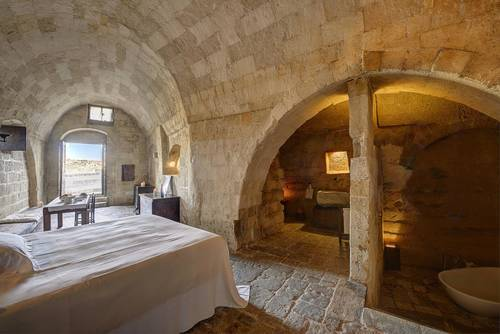 Room with a view and a bathroom in a cave