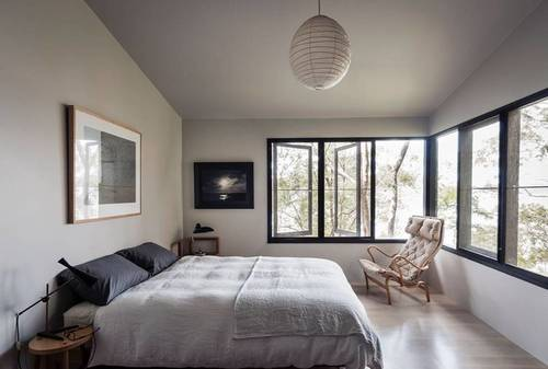The master bedroom has huge windows which let lots of light in