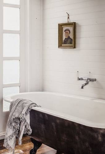 It's all about the bath — views out over the bay from this restored clawfoot