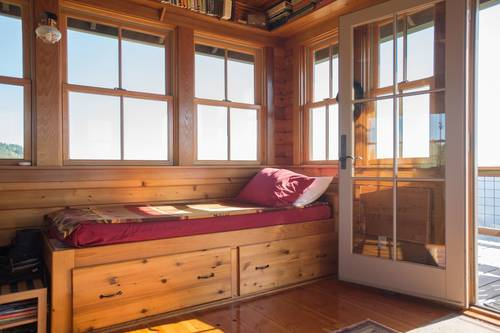 Twin bed in one of the cabins