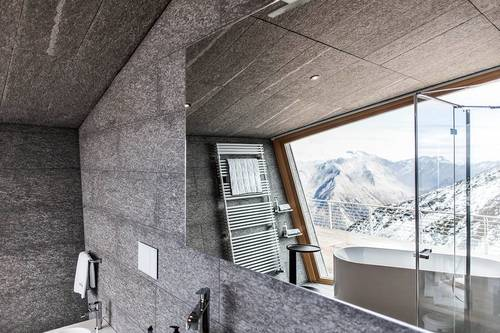 The stunning snow capped mountains as seen from the bathroom