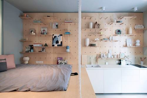 Smart storage on the walls keeps everything out of the way