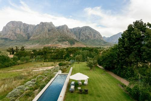View of the property, the pool and surrounding mountain ranges
