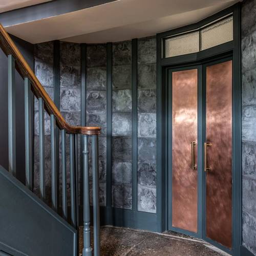 The entry-way with stunning copper doors