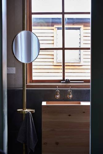 The bathroom with brass pedestal night light