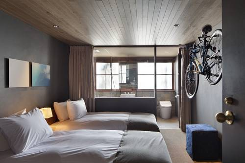 One of the twin rooms with bicycle storage space