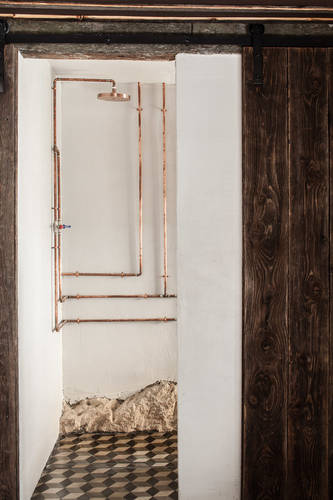 Exposed copper pipes in the bathroom