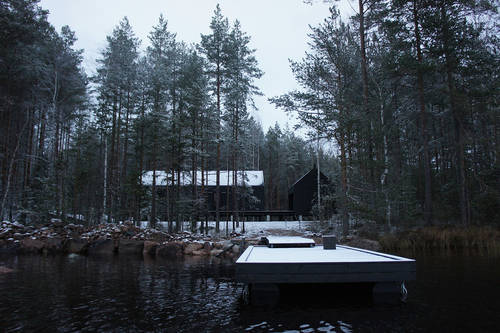 The snow-covered deck that extends out onto the nearby lake in winter