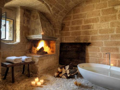 Room with a bath and fireplace
