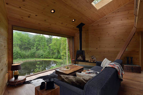 Interior of the cabin with a beautiful view over the surrounding forest